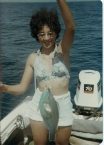 My daughter, Terri, with a Blue Parrot Fish caught off Islamorada, FL, circa 1976